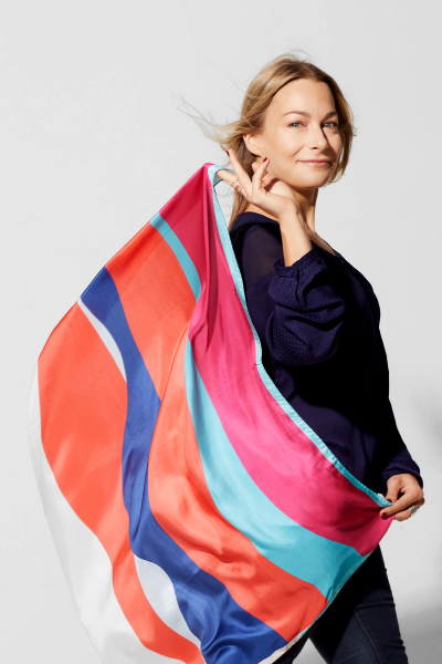 3_awol-about-the-artist_woman-holding-colorful-silk-scarf-in-the-wind