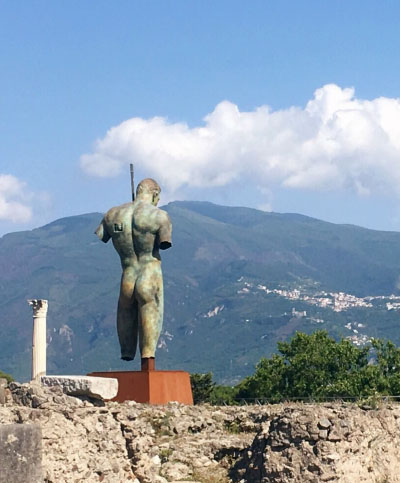 1-awol-lookbook-travel photography of pompeii mountain statue blue sky