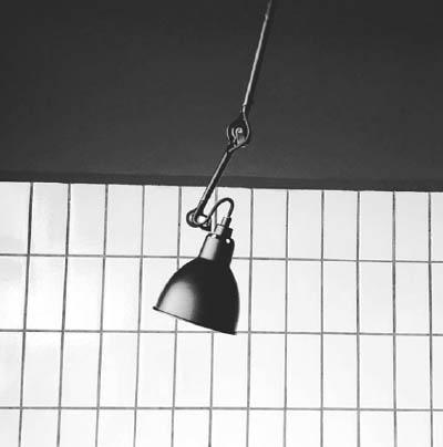 6-modern minimalist danish retail design_black and white wall grid design with danish lamp in copenhagen restaurant_creationawolc.com