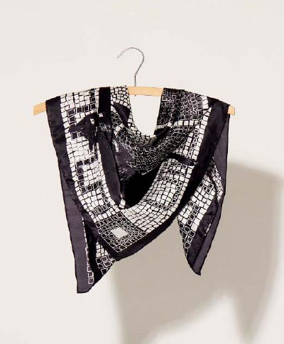 7 black and white mosaic silk scarf wrapped around a hanger