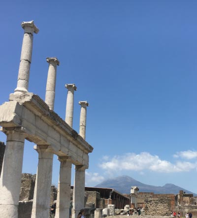 9 travel photography of pompeii ruins in italy with mountain and a beautiful blue sky